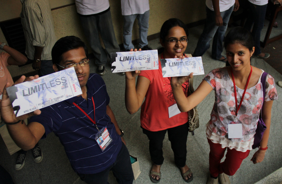 Students at PES Institute of Technology in Bangalore hold up their TEDx tickets. Photo: Courtesy of TEDxPESITBSC