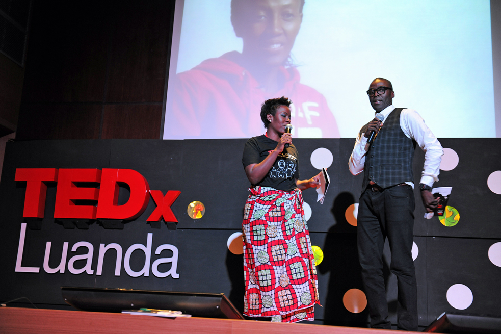 TEDxLuanda is the only event in the nation of Angola. Organizer Januario Jano (right) introduces the event with TK (left)