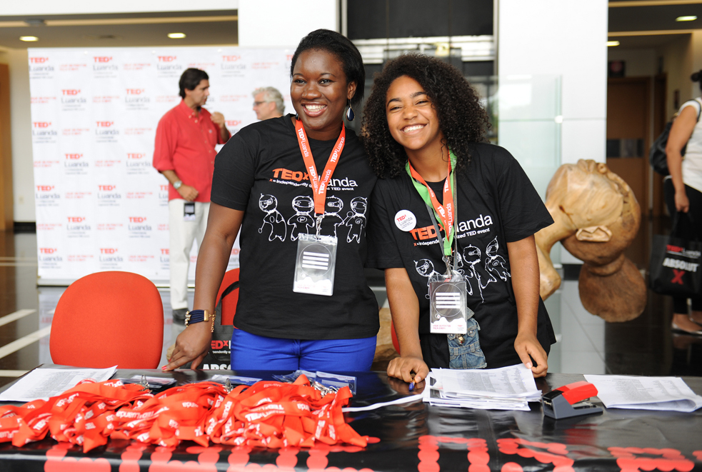 TEDxLuanda volunteers pose excitedly at the welcome table. Photo: Midan Studio