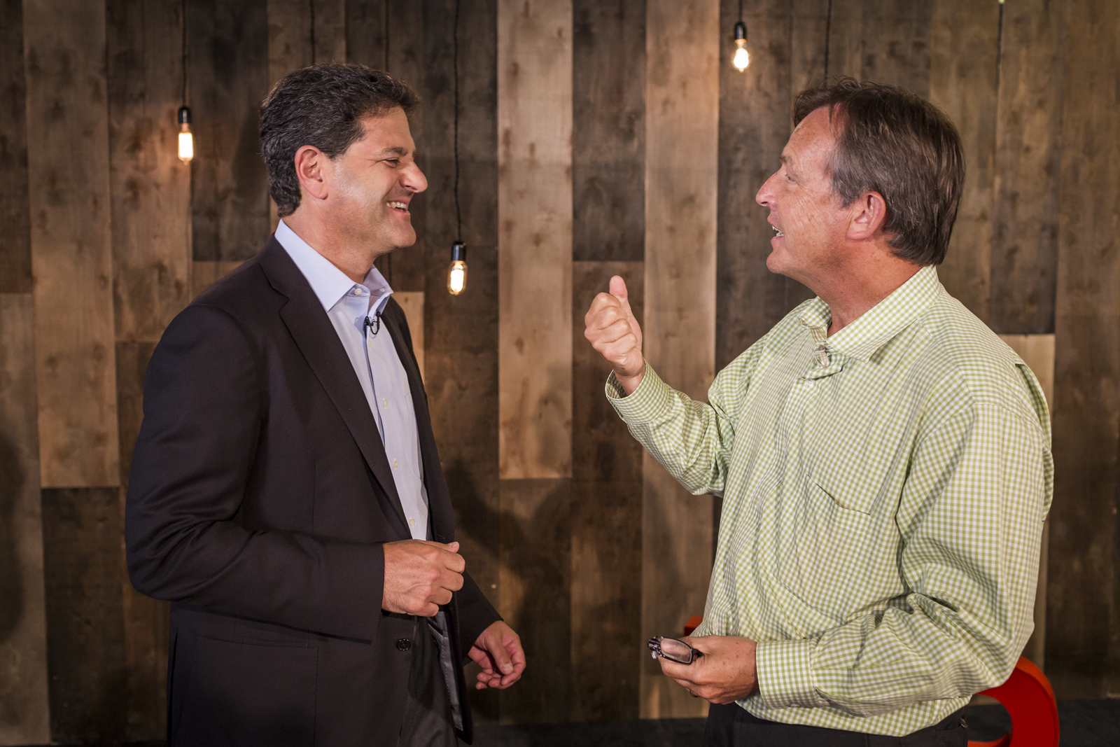 """Nick Hanauer and TED Curator Chris Anderson are both """"really bad at holding grudges."""" Here, the two talk before an in-office event. Photo: Ryan Lash"""
