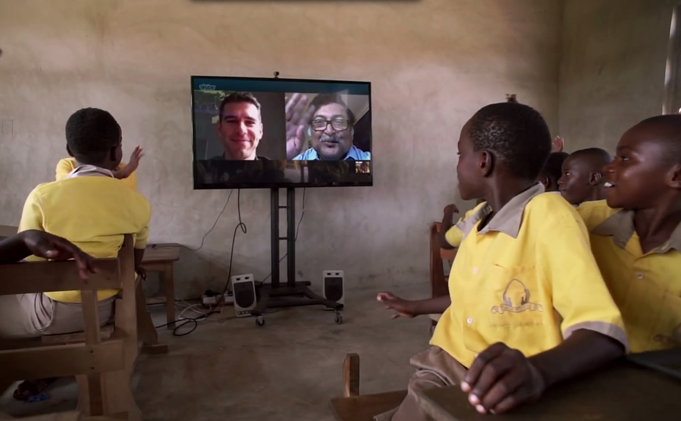 Students at the Pencils of Promise Omega School in Ghana talk to Adam Braun and Sugata Mitra remotely. Photo: Microsoft Work Wonders Project
