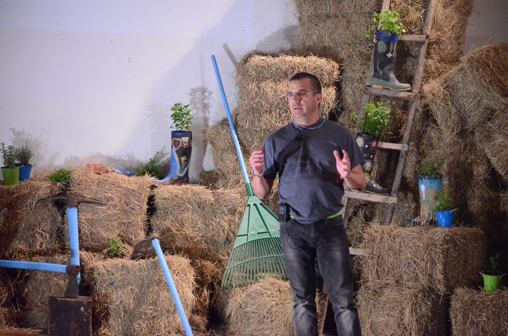 The TEDxGuatavita stage was especially notable for its design—bales of hay, farm equipment, and plants in boots. Photo: Courtesy of Philipe Spath