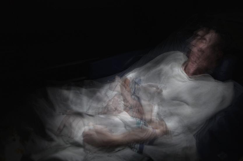 "Photographer Kitra Cahana turned her camera on her father, Rabbi Ronnie Cahana, to capture his experience with ""locked-in"" syndrome. From ""Father; Inchoate, Sub-Planetary, Protozoan."" Montreal, Canada, 2013. Photo: Kitra Cahana"