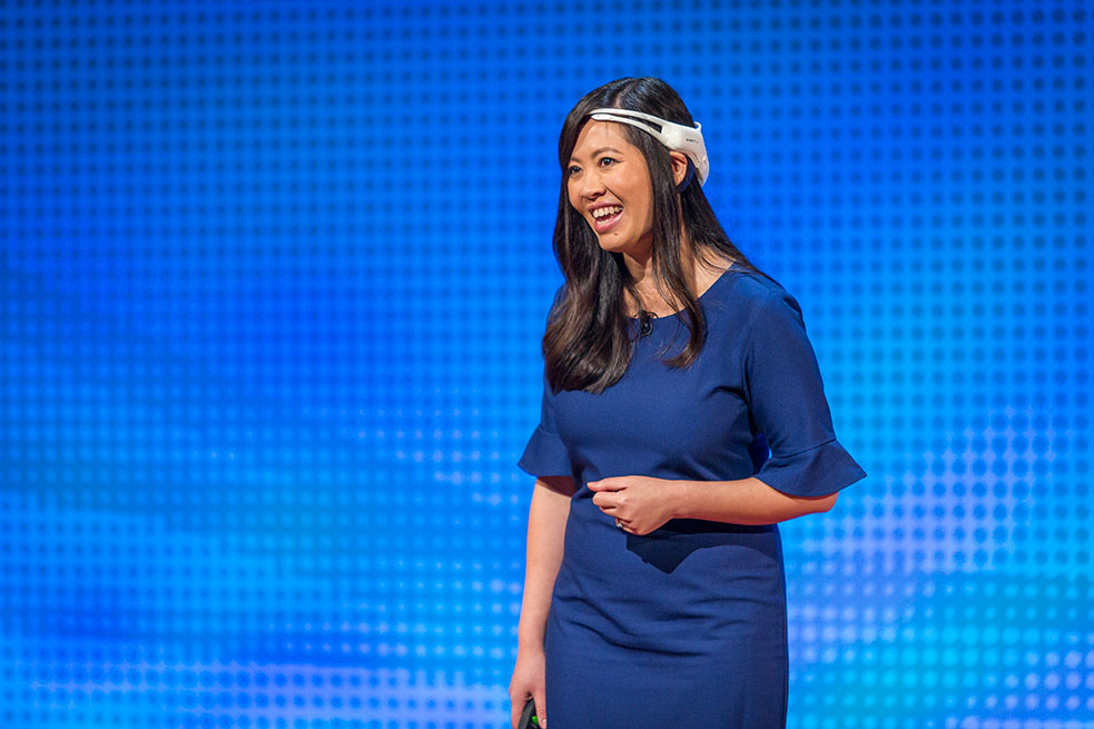 Tan Le wore a headset on stage that allowed attendees to look at her brain activity, live. Photo: Marla Aufmuth/TED