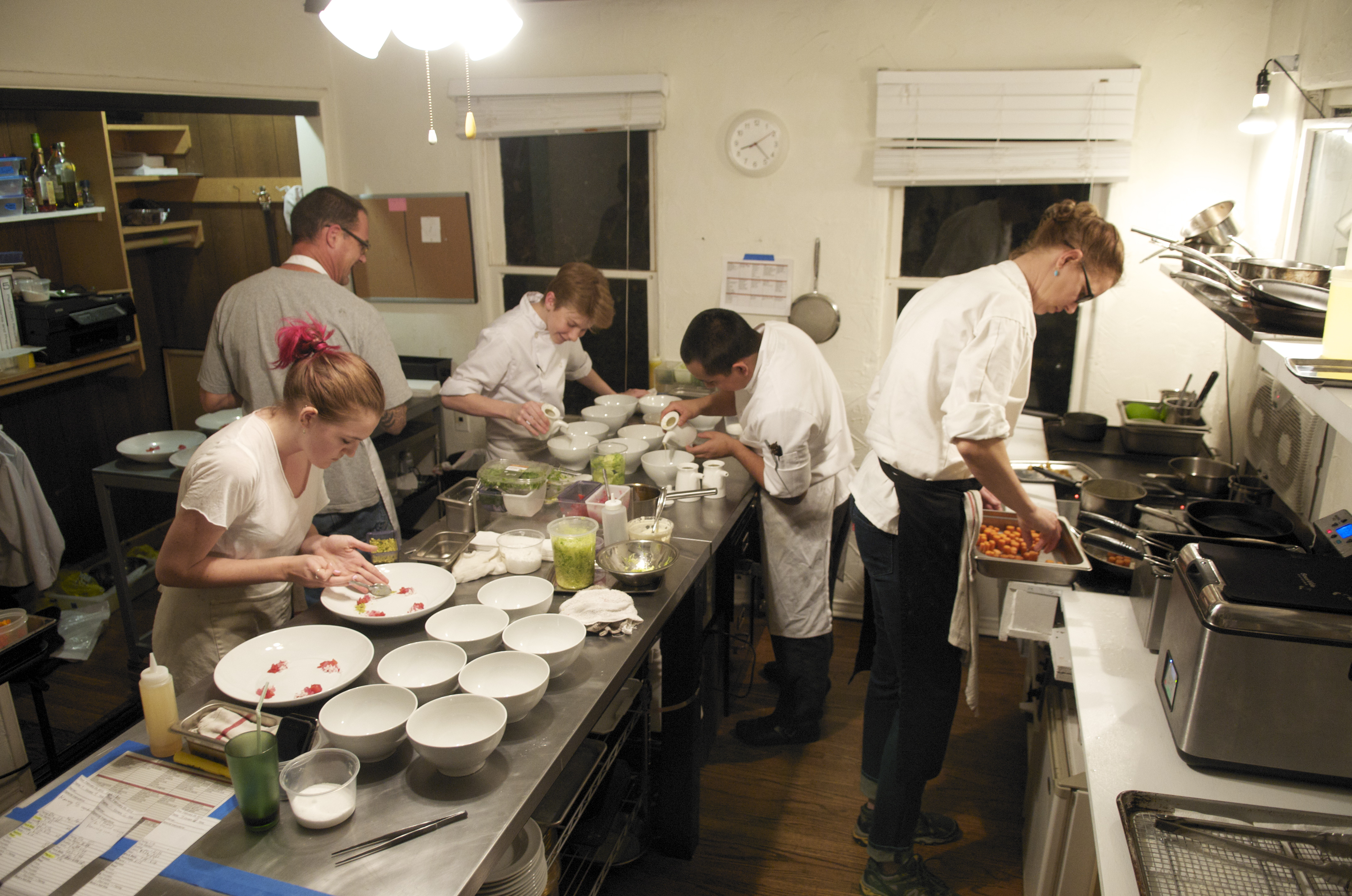 Chef Flynn McGarry, just 15-years-old, supervises plating at EUREKA, his monthly supper club that now has a cult following.