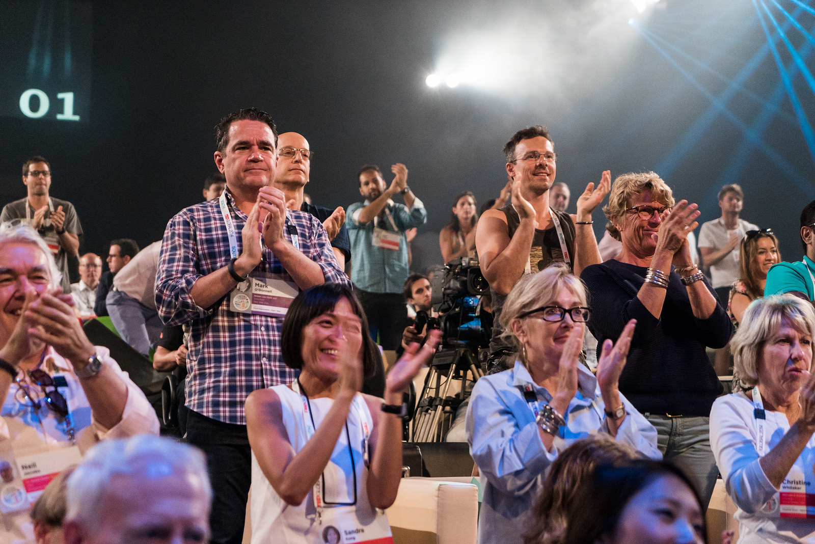 Audience members give a hearty standing ovation to speaker Oren Yakobovich. Photo: James Duncan Davidson