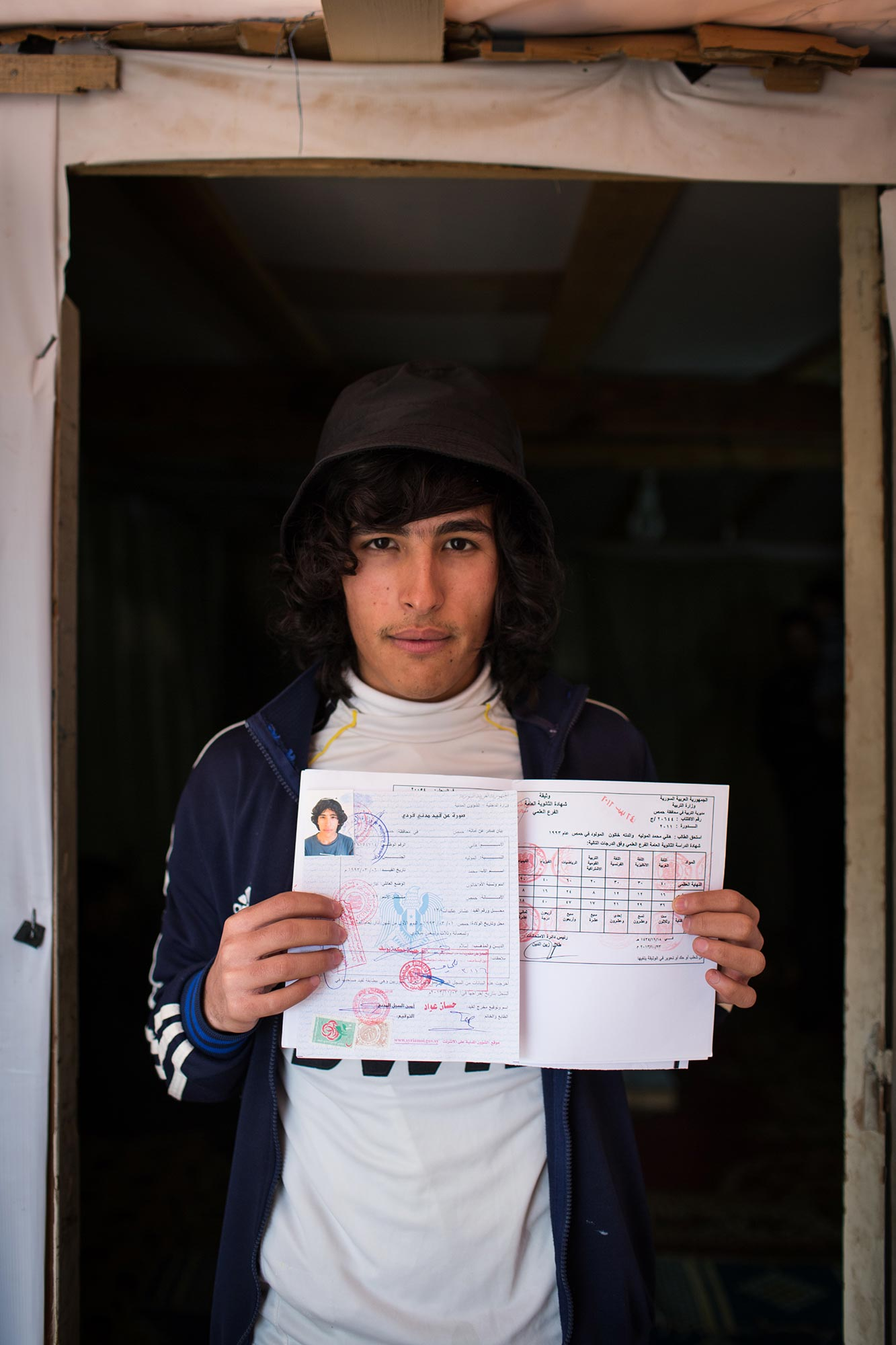 Syrian refugee Hany and his high school diploma / Photo by: Andrew McConnell, UNHCR