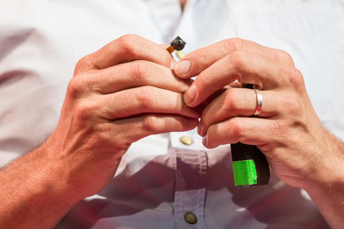 Close-up of miniature camera held by Oren Yakobovich at TEDGlobal 2014.