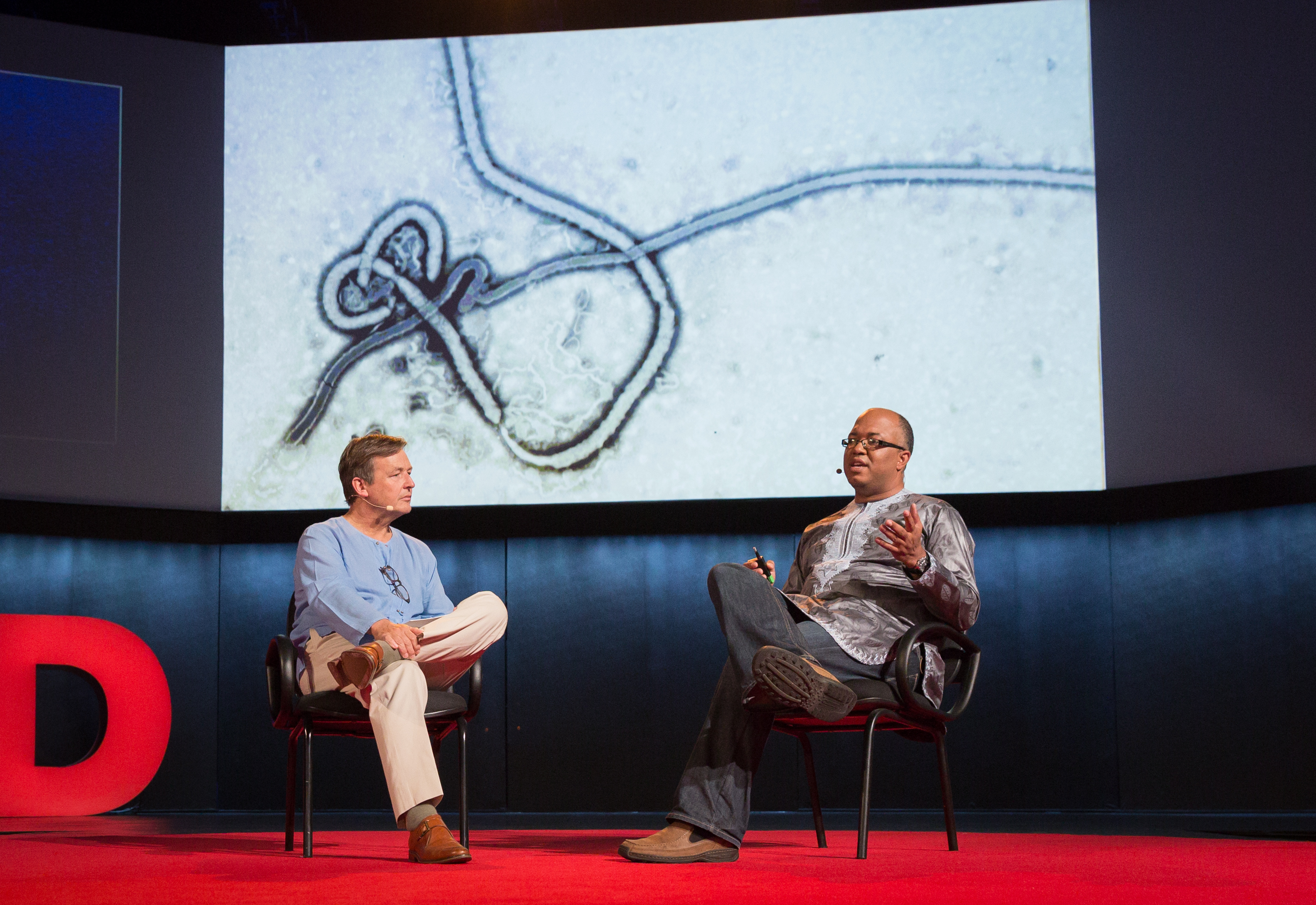 (L-R) Host Chris Anderson speaks with Chikwe Ihekweazu at TEDGlobal 2014. Photo: James Duncan Davidson/TED