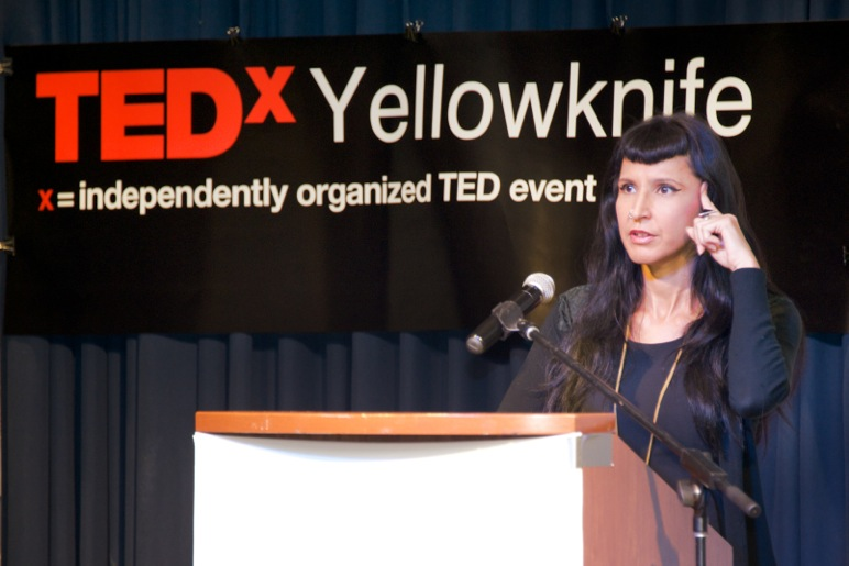 A speaker at the TEDxYellowknife podium. Photo: Courtesy of TEDxYellowknife