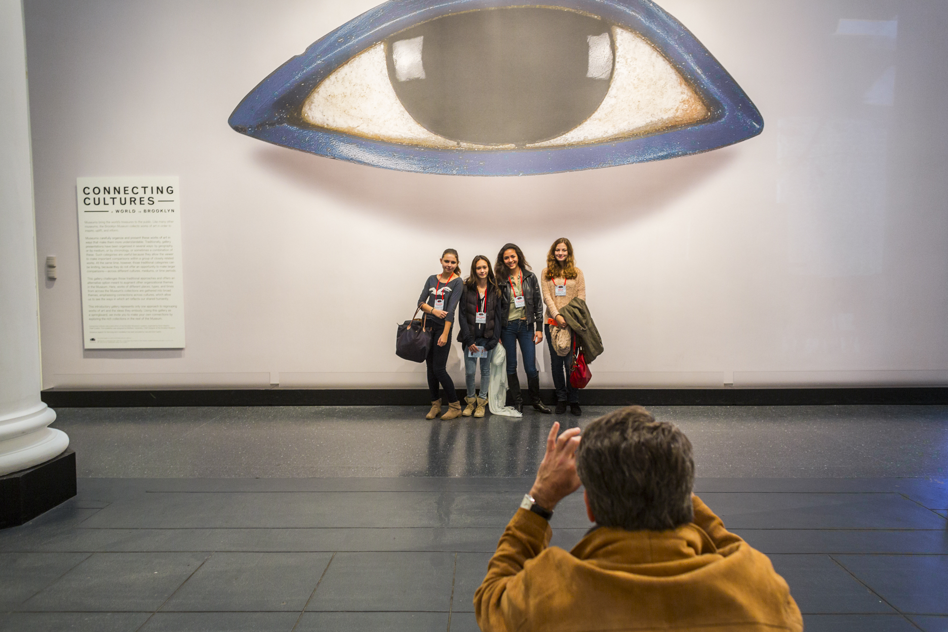 Attendees snap a photo under a piece of art at the Brooklyn Museum. Photo: Ryan Lash/TED