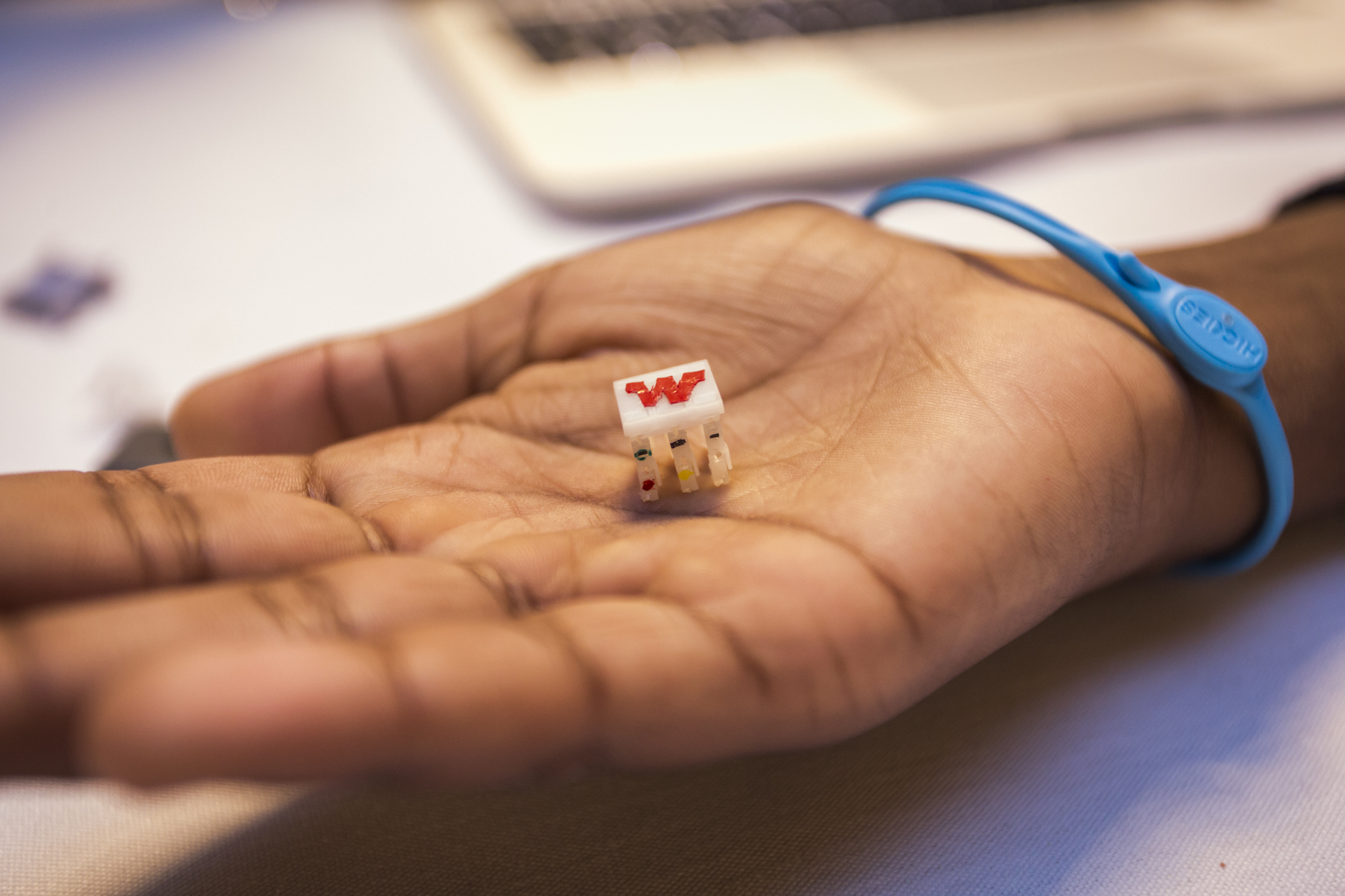 An attendee holds one of Sarah Bergbreiter's tiny, tiny robots in the palm of her hand. Photo: Ryan Lash/TED