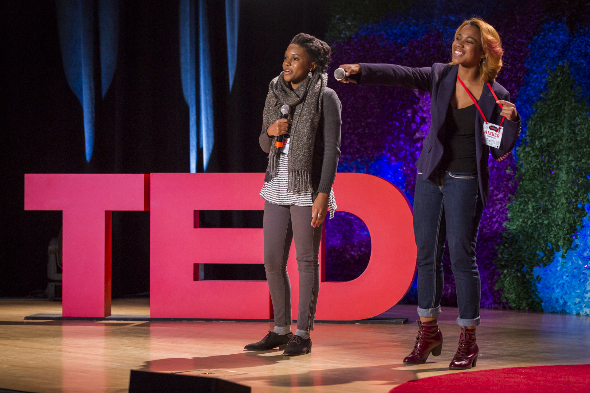 Two attendees (and hip hop enthusiasts) introduce the next speaker, Tahir Hempill of the Hip Hop Word Count. Photo: Ryan Lash/TED
