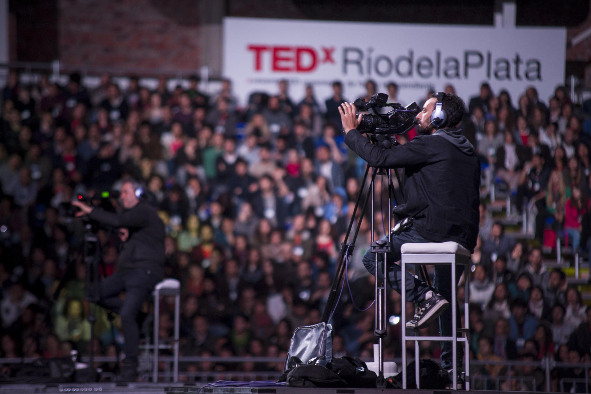 A cameraman nestled amongst the crowd. Photo: