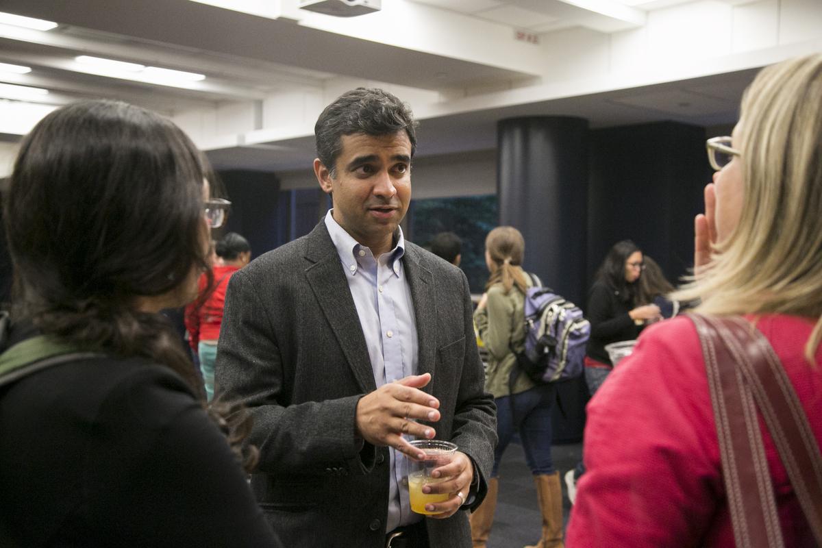 Rishi Manchanda socializes with students after speaking on Tufts campus. Photo: Kelvin Ma/Tufts University