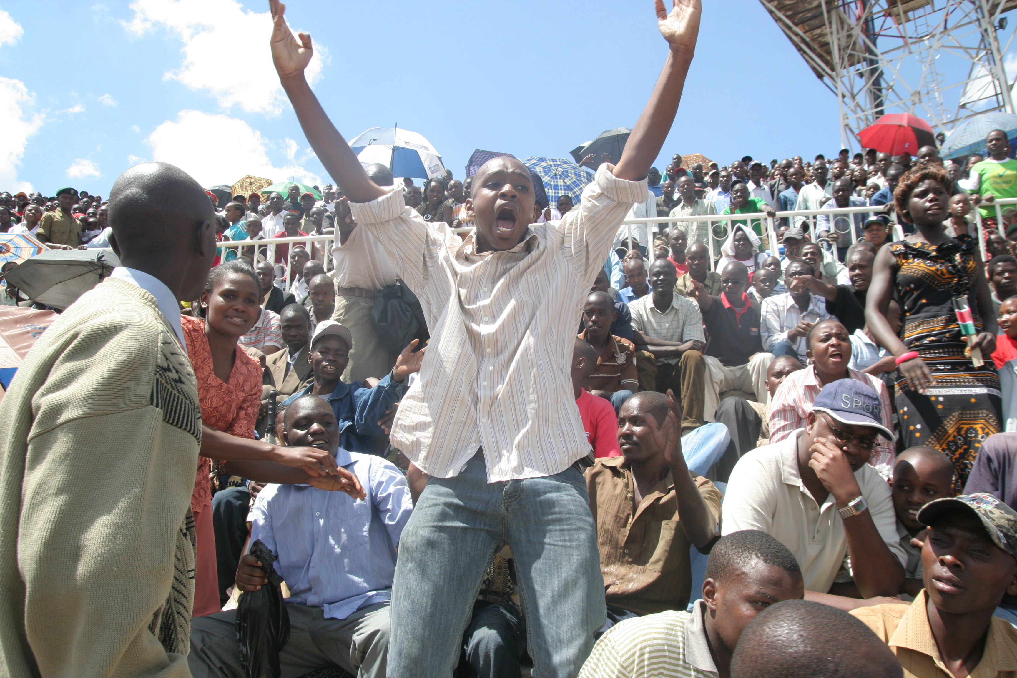 The moment of truth: Boniface Mwangi stands up alone to protest on June 1, 2009. He was arrested, beaten and jailed. Photo courtesy of Boniface Mwangi