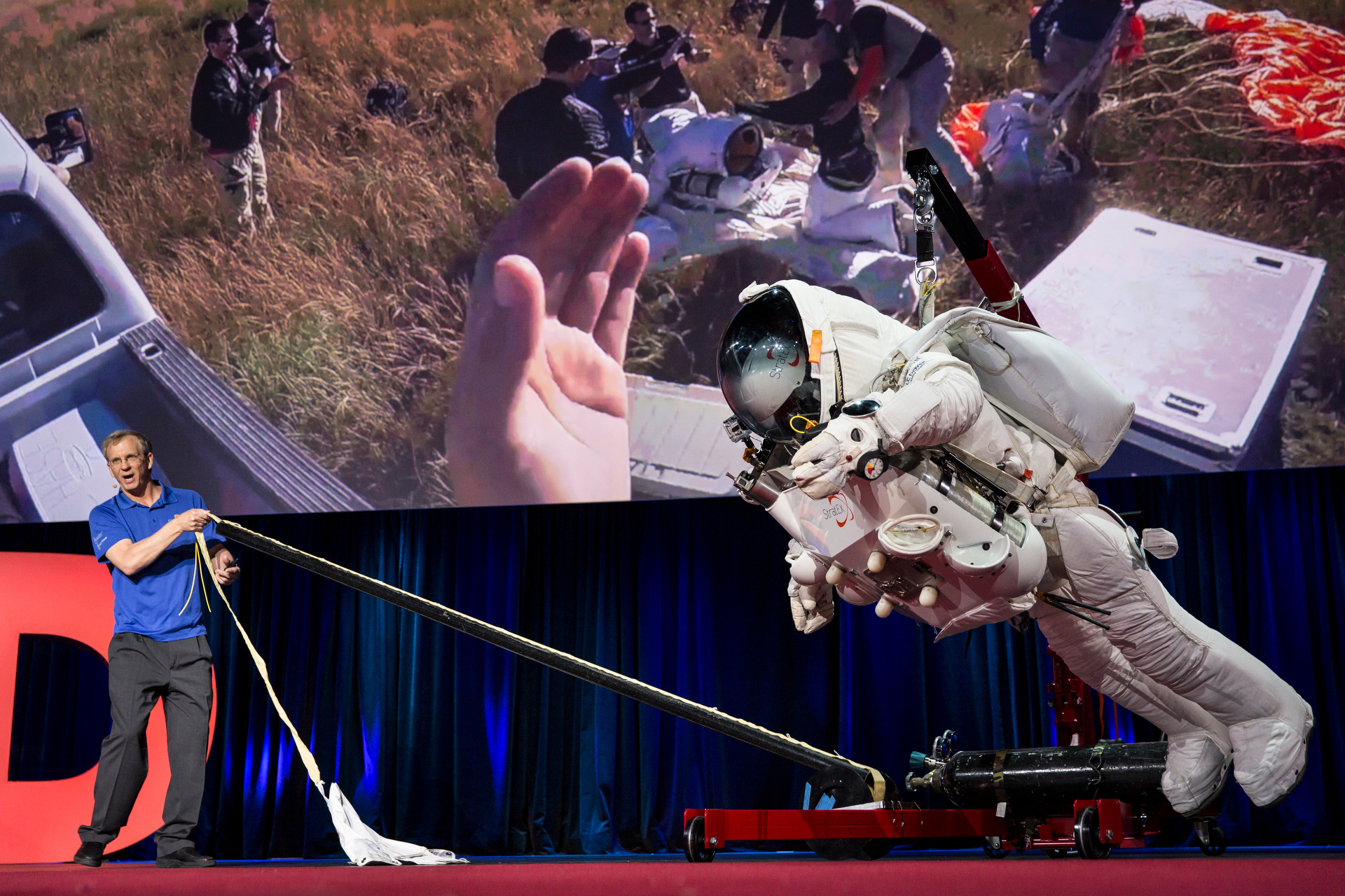 Alan Eustace demonstrates a clever feature on his stratosphere suit, a cord that forms a tube as it's pulled. This little design feature made sure he didn't get tangled in his parachute as he beat Felix Baumgartner's record. Photo: James Duncan Davidson/TED