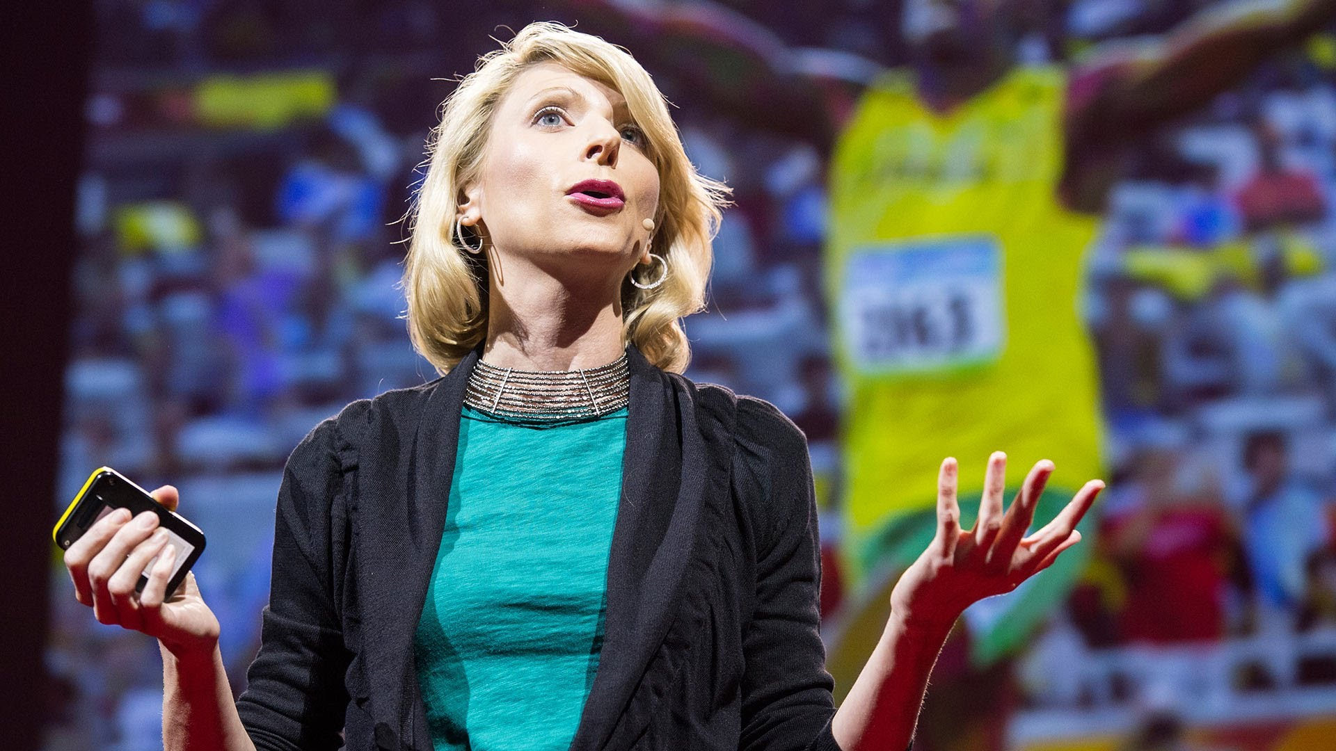 """Amy Cuddy chose a green top and a cool necklace to wear for her TED Talk, rather than a fancy dress. """"I wanted to be myself, not a red carpet version of myself.,"""" she tells The New York Times. Photo: James Duncan Davidson/TED"""