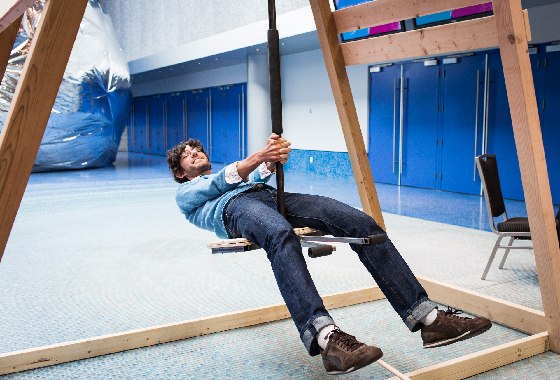 An attendee takes a ride on a Harmonograph Swingset. Read more about it. Photo: James Duncan Davidson/TED