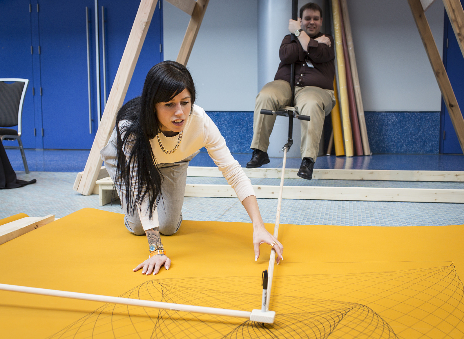 Artist and inventor Carley Stadelmann helps retrieve an image from the swingset. Photo: James Dunan Davidson/TED