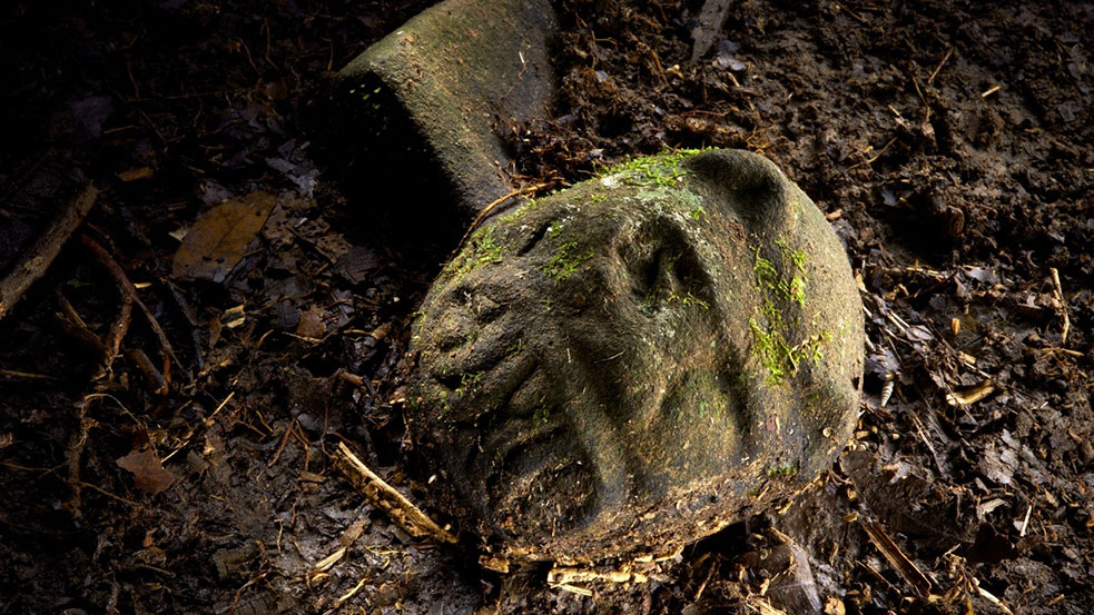 """The """"jaguar stone"""" is one of  more than 50 artifacts found in the Río Plátano Biosphere Reserve in Honduras. TED speaker Mark Plotkin finds it especially interesting because while it is part jaguar, it is clearly part man too—feeding into legends of shamans who trasnform into jaguars. """"When I saw that carving on the forest floor, it sent shivers down my spine,"""" he says.  Photo: Dave Yoder, courtesy of the National Geographic"""