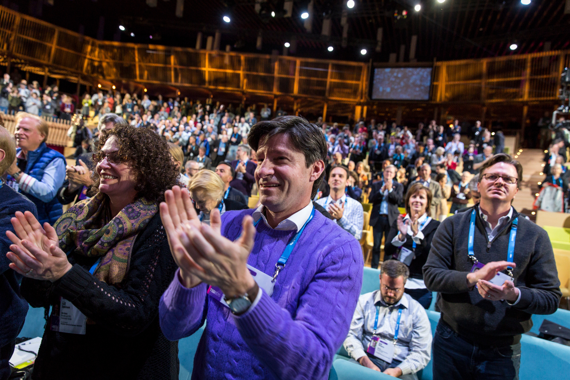 The audience hops to its feet for a standing ovation. Photo: Bret Hartman/TED