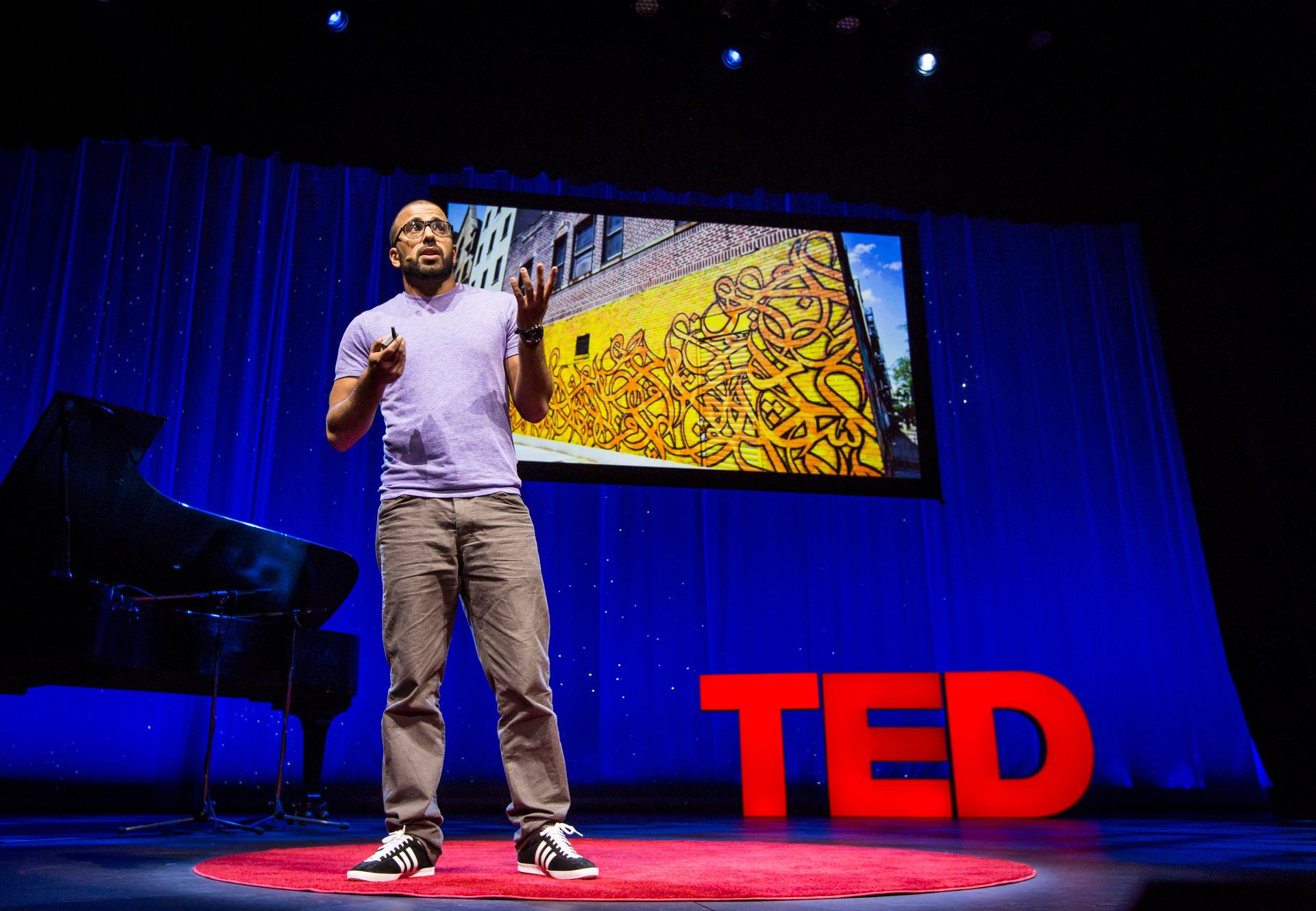 eL Seed speaks about his Arabic calligraphic graffiti art during Fellows session 2, TED2015 - Truth and Dare, March 16-20, 2015, Kay Meek Center, West Vancouver, Canada. Photo: Ryan Lash/TED