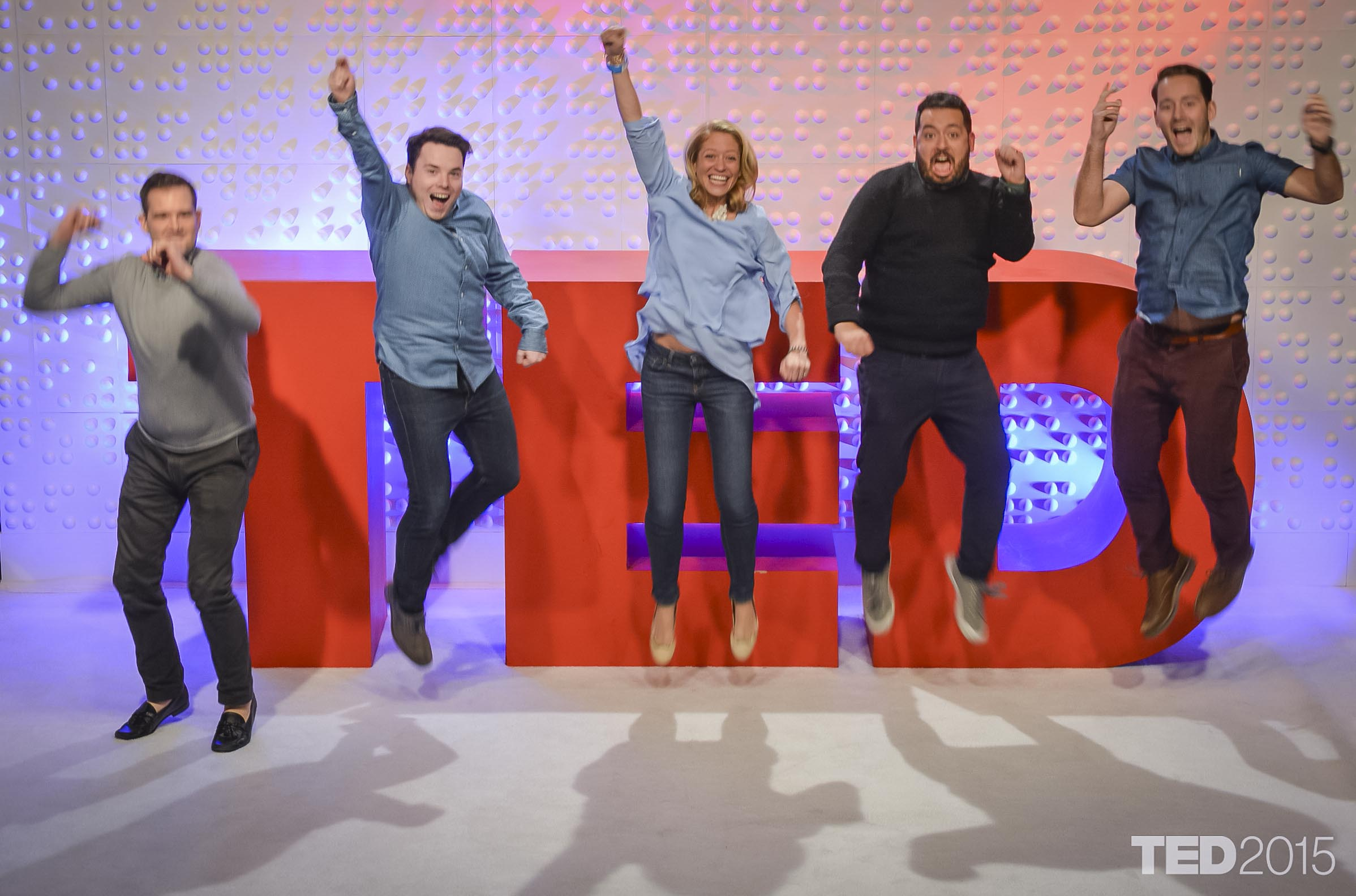 TED's dynamic press relations team, led by Margaret Sullivan, center, jump for joy.
