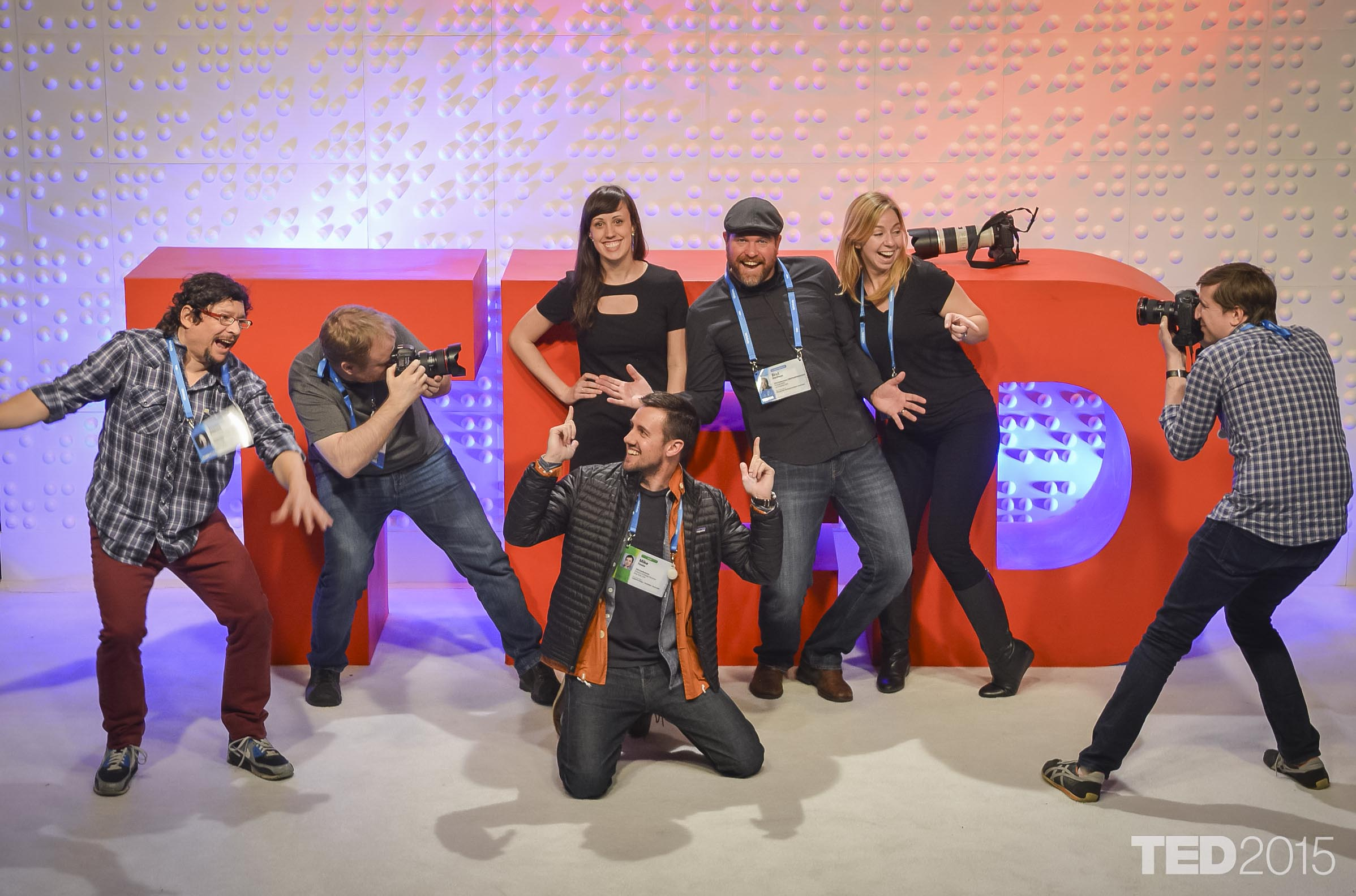 The TED2015 photo team -- Jason Redmond, James Duncan Davidson, Emily Pidgeon, Bret Hartman, Stacie McChesney, Ryan Lash -- surround TED's design director, Mike Femia.