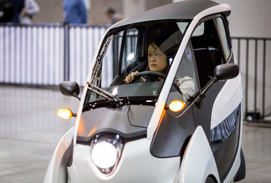 Thu-Huong Ha drives the Toyota i-Road concept vehicle at TED2015.