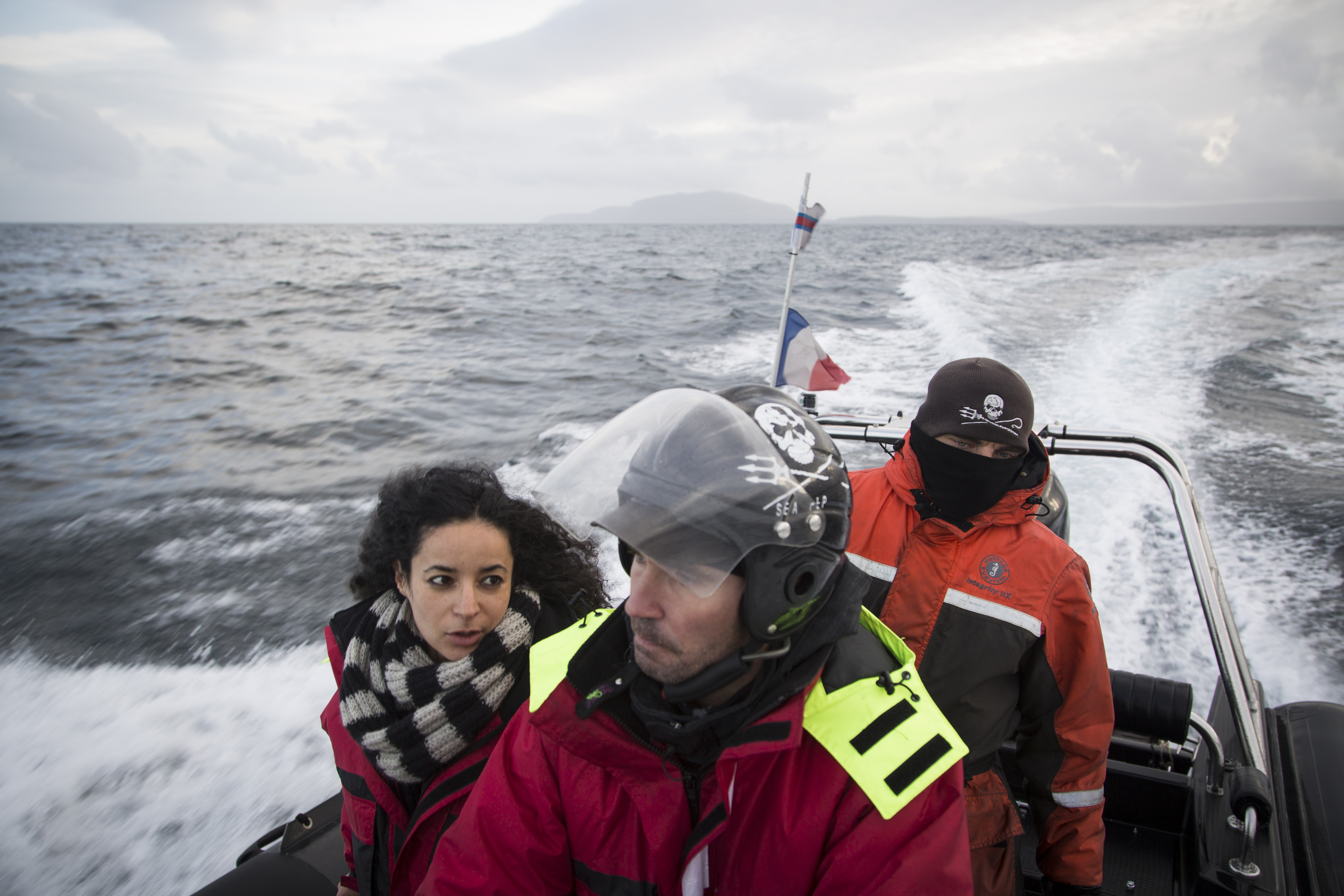 Members of the Sea Shepherd boat crew, including Lamya Essemlali (left), patrol the waters for whales surrounding the Faroe Islands on September 22, 2014. In 2014, hundreds of volunteers from Sea Shepherd descended on the Faroe Islands to interfere with the whale hunt, which they say is barbaric and unnecessary. Photo: Ed Ou Reportage: Getty Images