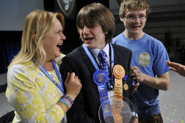Jane (left) and Luke (right) congratulates Jack (center) on his win at the The Intel International Science and Engineering Fair. Photo: Courtesy of the Andrakas