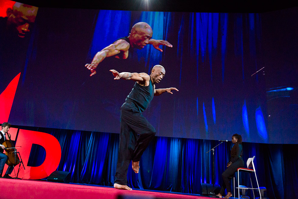 """Red and blue came together in this structured improvisation from legendary dancer Bill T. Jones, cellist Joshua Roman and vocalist Somi, hence the title, """"The Red Circle and the Blue Curtain."""" The blue curtain is a reference to Isadora Duncan. Photo: Bret Hartman"""