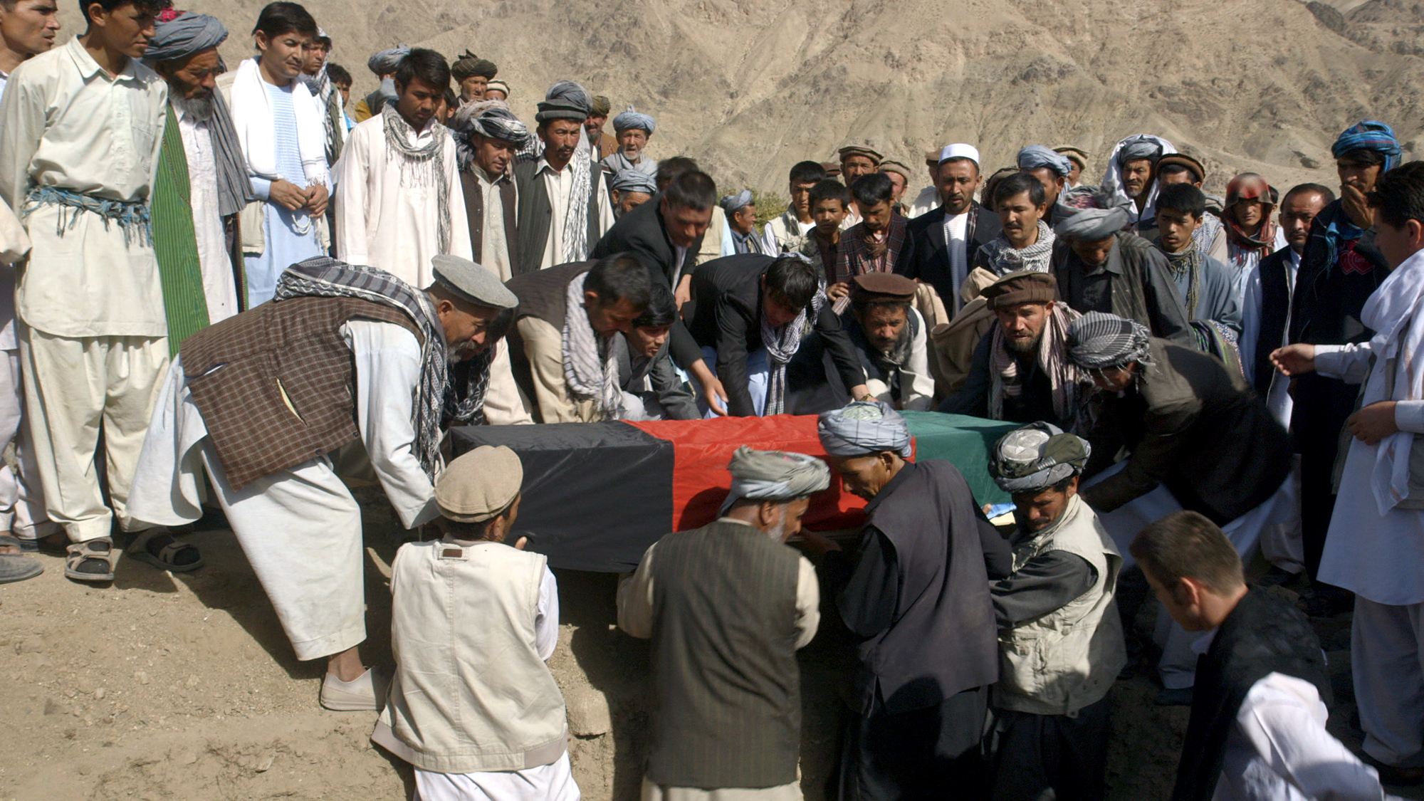 The Nazar family bury their son -- a soldier in the Afghan National Army -- in Baghlan in northeastern Afghanistan.