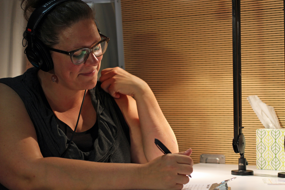 Emily Janssen, in her facilitator's seat in the StoryCorps mobile recording booth. Photo: Courtesy of Emily Janssen