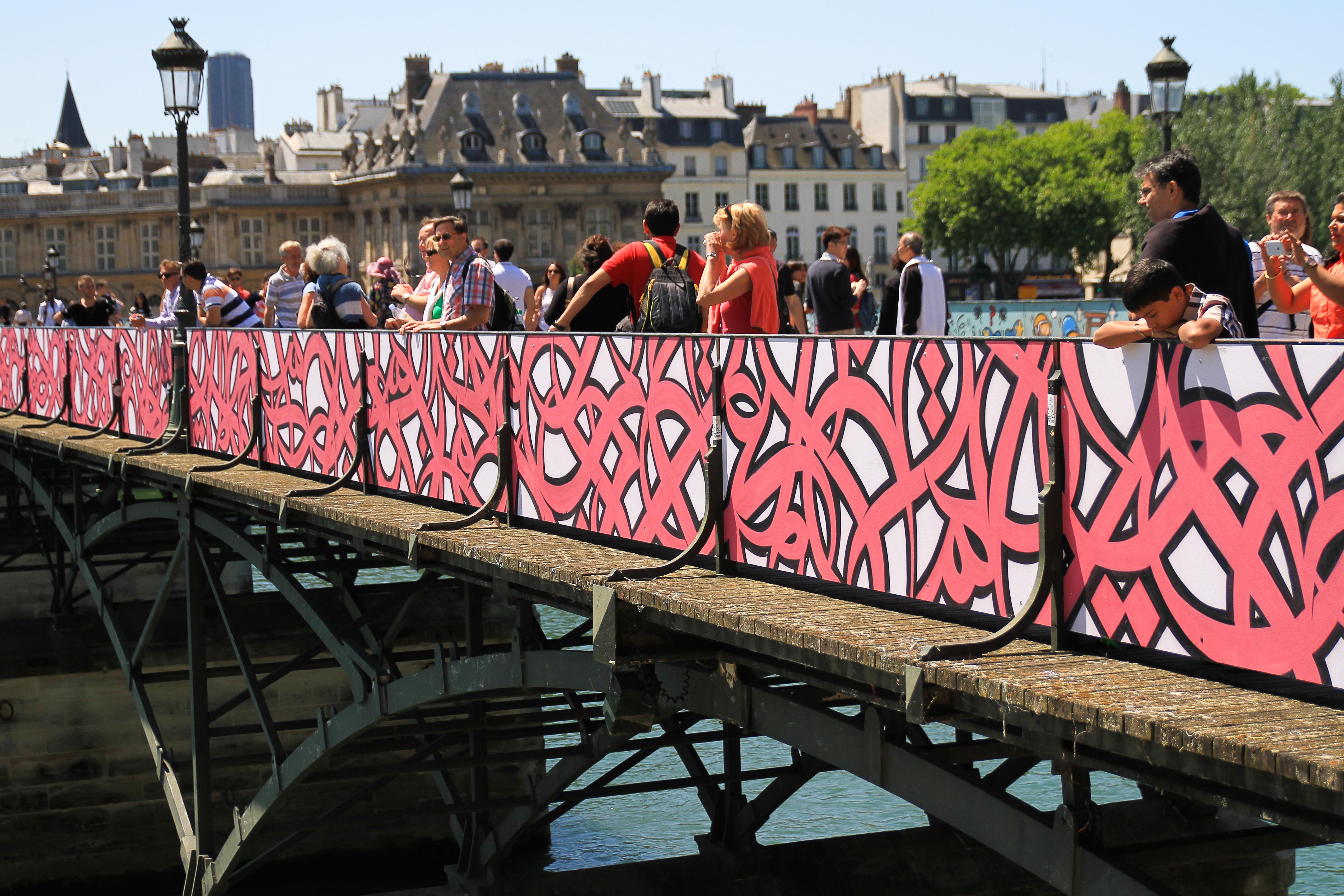 """""""Paris is a veritable ocean. Plumb it, you will never know its depths."""" -- Honoré de Balzac. Pont des Arts, Paris, France. Image courtesy of eL Seed"""
