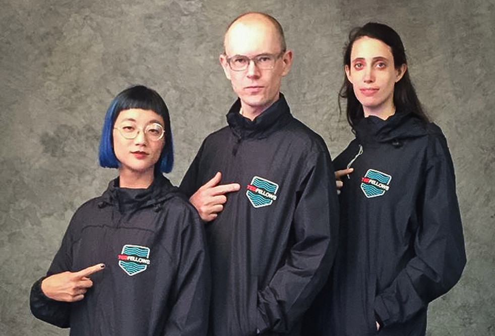 """We festooned the TED Fellows with a special retreat windbreaker -- modeled here by Christine Sun Kim, Chris Woebken and Kitra Cahana. The chevron-shaped embroidered patch has the 'Swimming Against the Tide' logo."" Photo: Bret Hartman/TED"