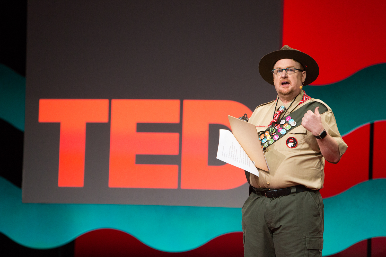 Be prepared: TED Fellows director Tom Rielly opens the first session of the TED Fellows Retreat talks in Scoutmaster regalia. Photo: Ryan Lash