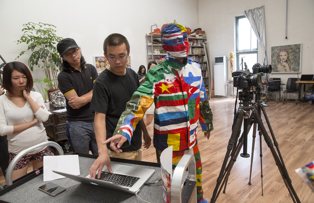 Liu Bolin used a wall in his Beijing studio to create 'The Future.' Even without the backdrop, he is an artistic vision. Photo: Getty Images, courtesy of the UN