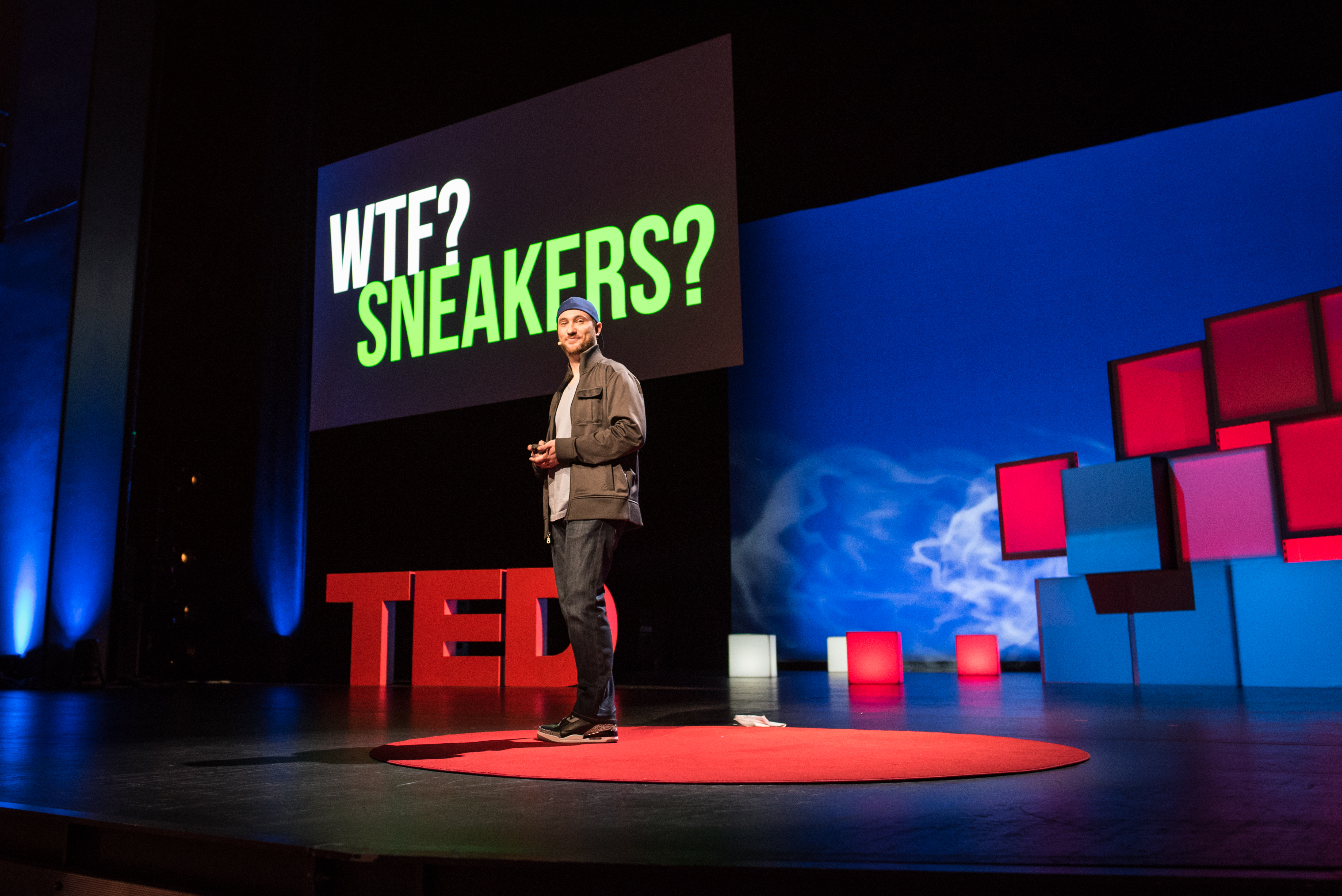 """Josh Luber is a """"sneakerhead."""" In a fun talk, he examined the unregulated secondhand sneaker market — a $6 billion a year business. Photo: Russell Edwards/TED"""