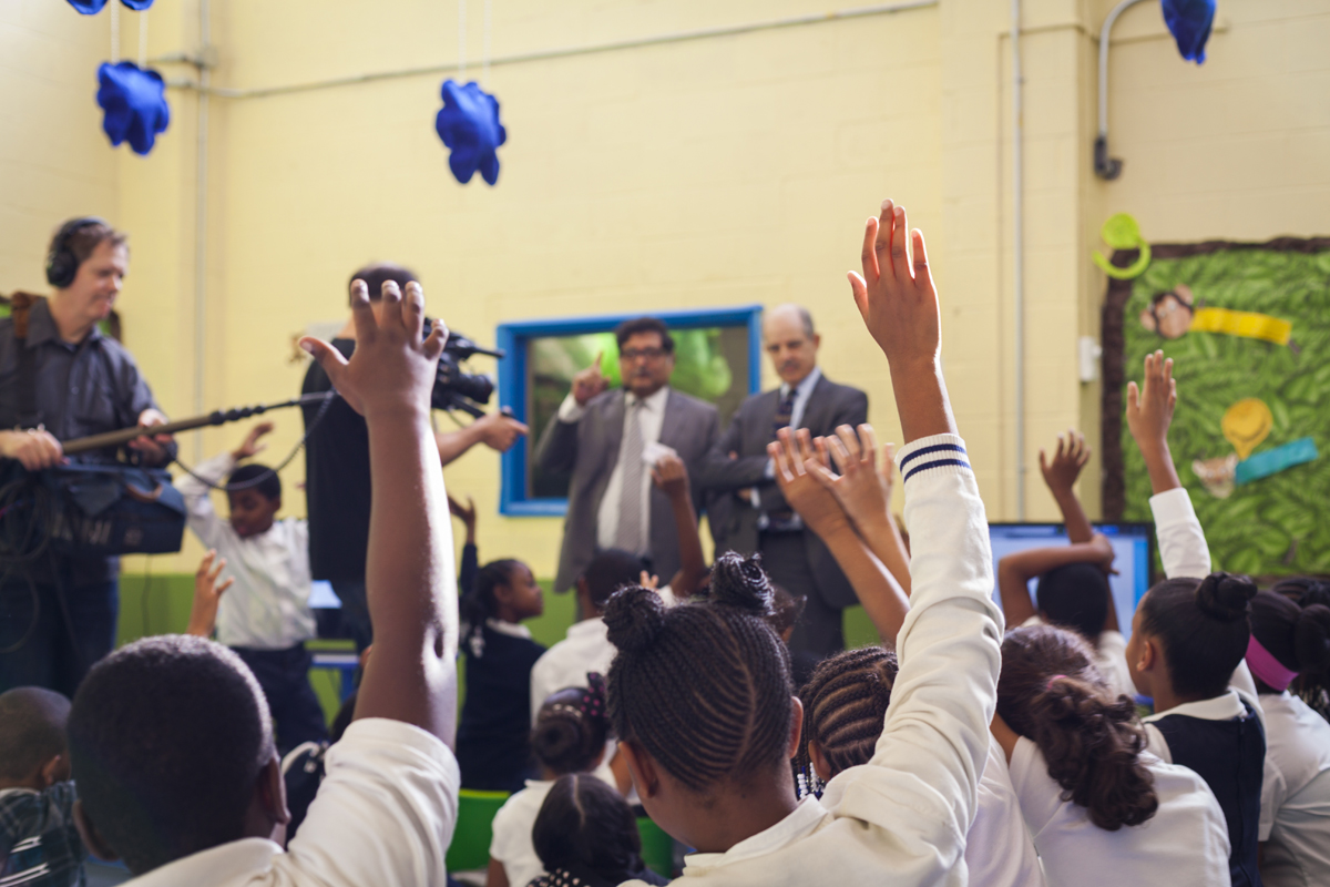 Students at John B. Russwurm Elementary School in Harlem raised their hands excitedly to ask questions of 2013 TED Prize winner Sugata Mitra. Photo: Dian Lofton/TED