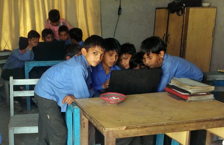 At Khud in Lahore, Pakistan, students learn to use computers — and give compelling presentations. Photo: Courtesy of Khud