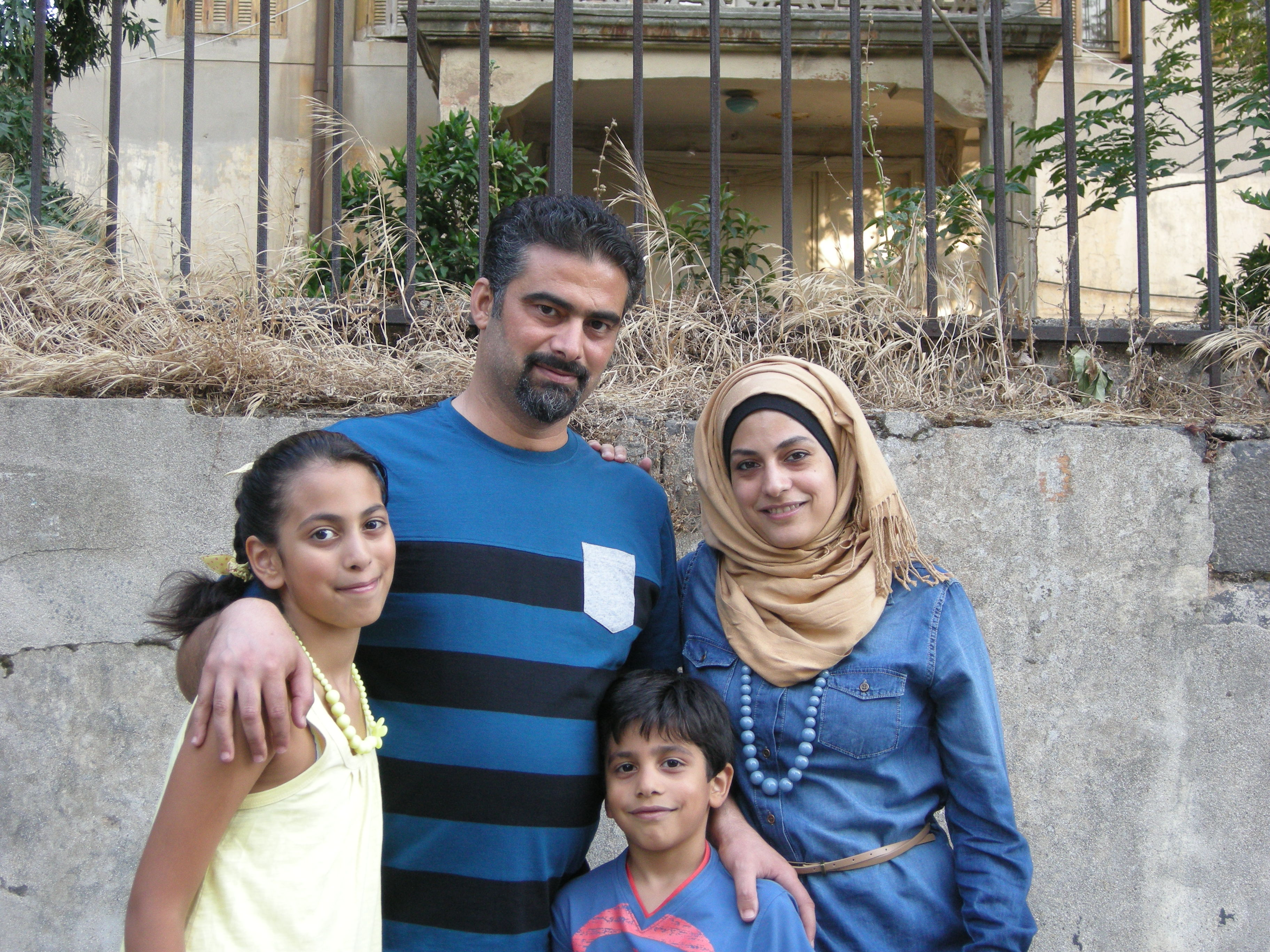 Marwa Al-Sabouni photographed earlier this year in Homs with her husband, Ghassan, their daugther Naya and son Ayk.