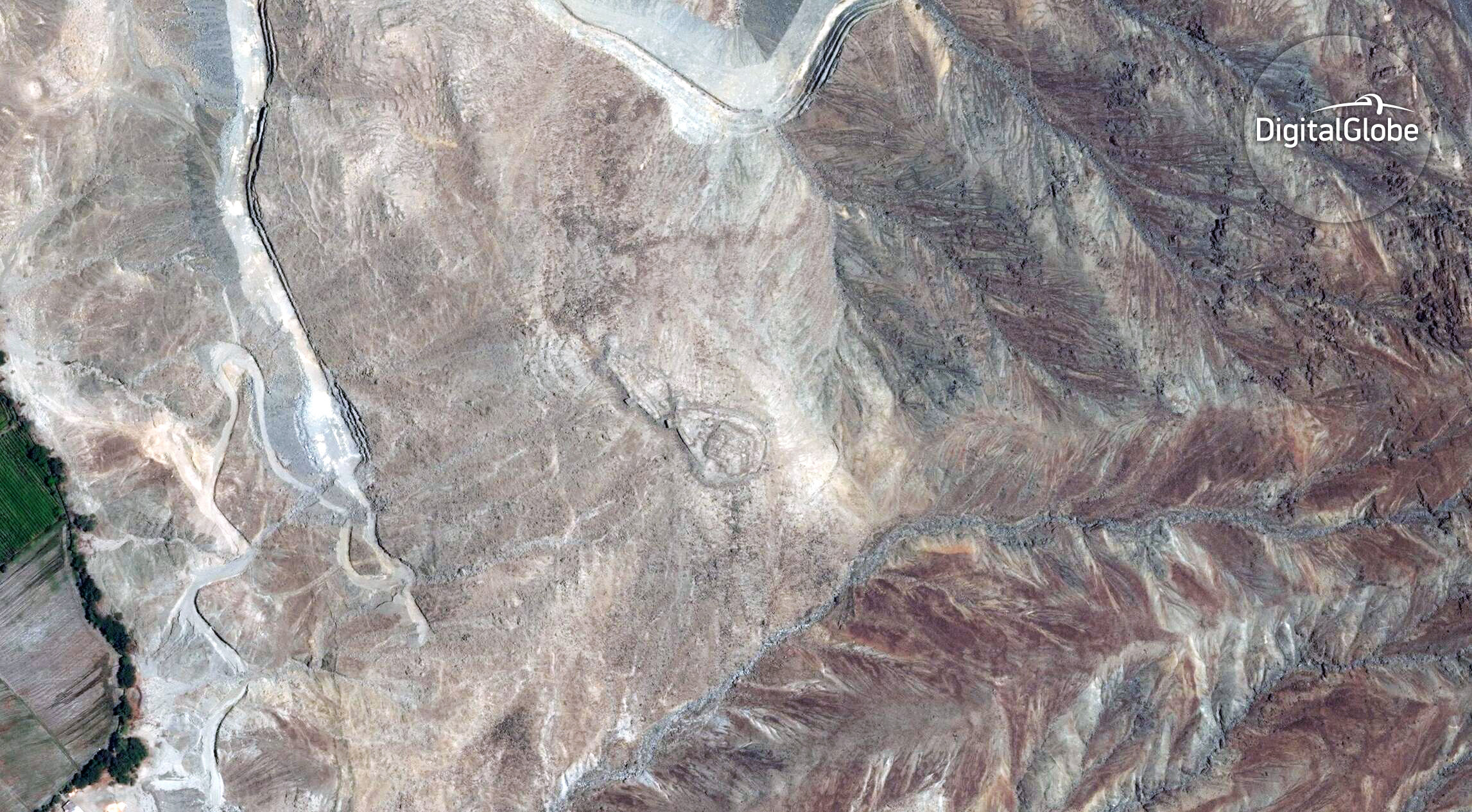 Users will search more than 200,000 square kilometers of satellite imagery. Large sections like this will be broken into smaller tiles — and archaeological features like this stone structure on a hill in Peru's highlands. Image: ©DigitalGlobe 2017