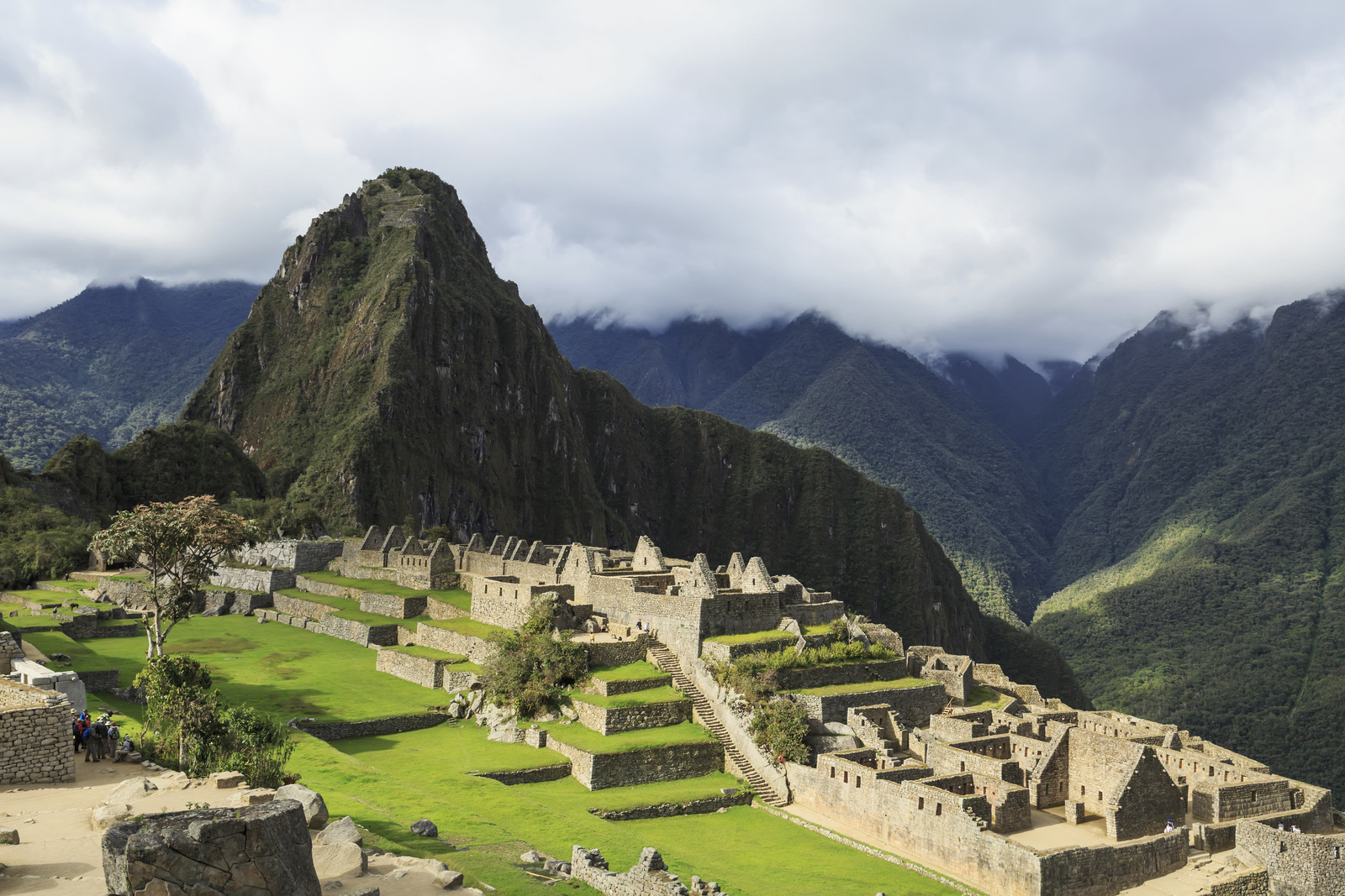 Morning fog and clouds reveal Machu Picchu, the ancient lost city of the Incas, one of Peru's top tourist destinations. Photo Credit: Design Pics Inc/National Geographic Creative