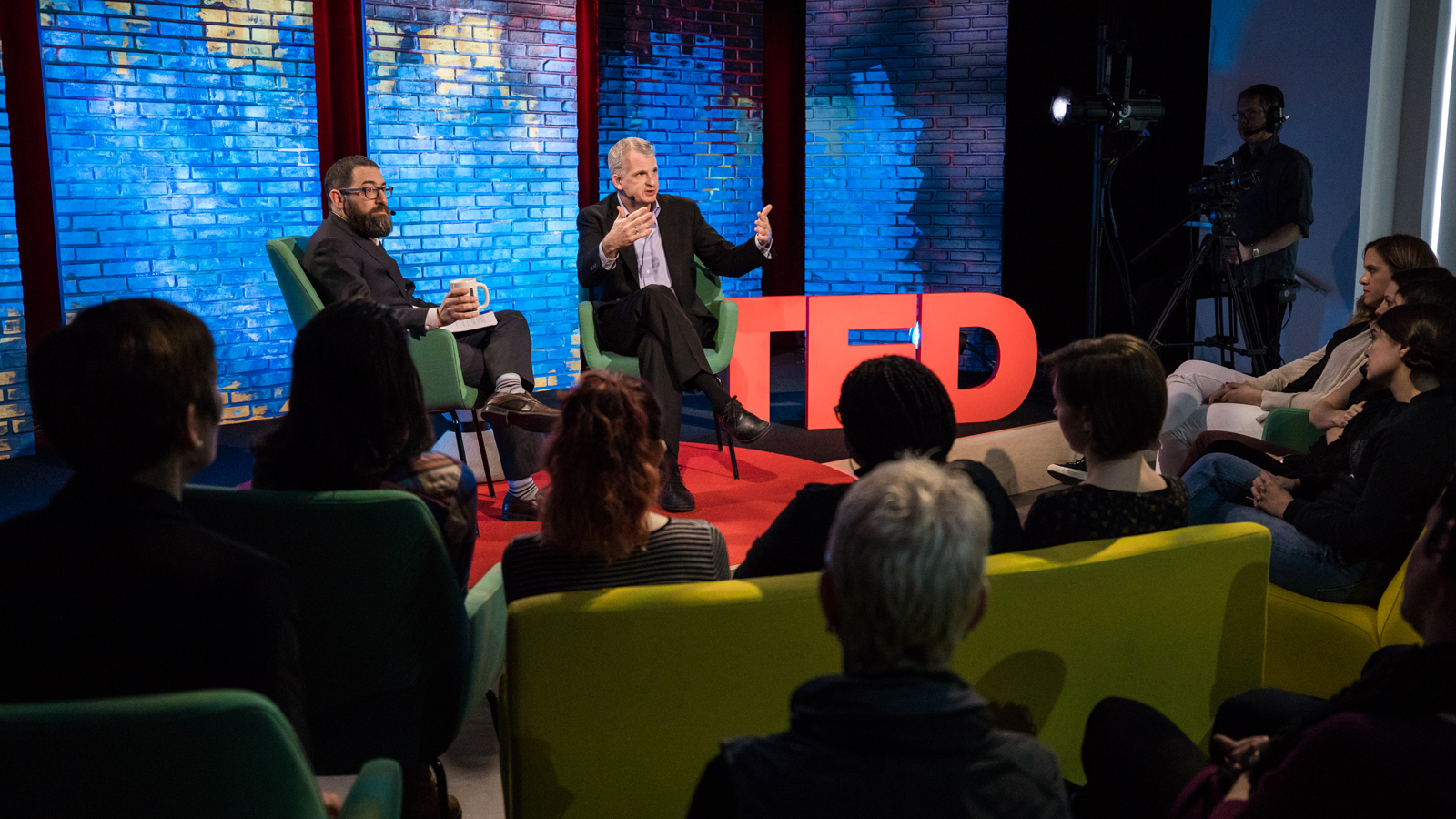 """Can we learn something from the past that helps us see more in the present?"" asks Timothy Snyder, right, onstage with historian Rick Perlstein, during TED Dialogues. February 23, 2017, at TED's offices in New York. Photo: Dian Lofton / TED"