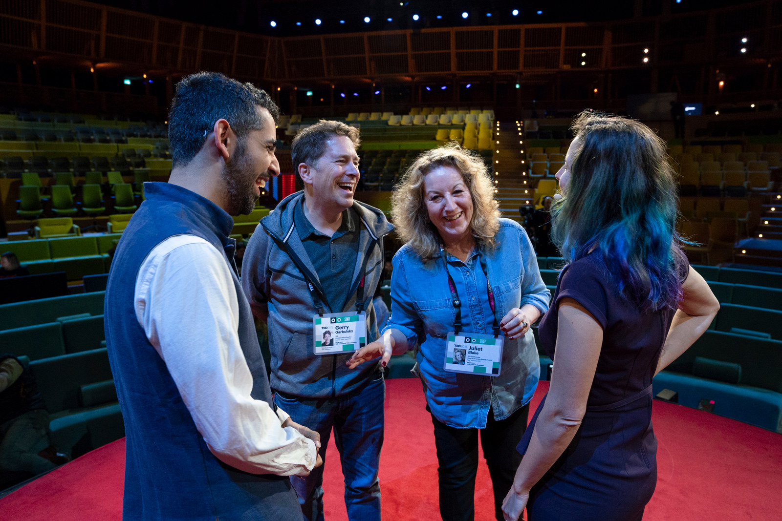 Before the conference opens, tree days of onstage rehearsals are a final opportunity to finesse scripts -- and a chance for speakers to get comfortable on the red circle. Here, curators Gerry Garbulsky and Juliet Blake, at center, review rehearsal notes with speakers Surya Mattu, far left, and Kashmir Hill, far right. Photo: Ryan Lash