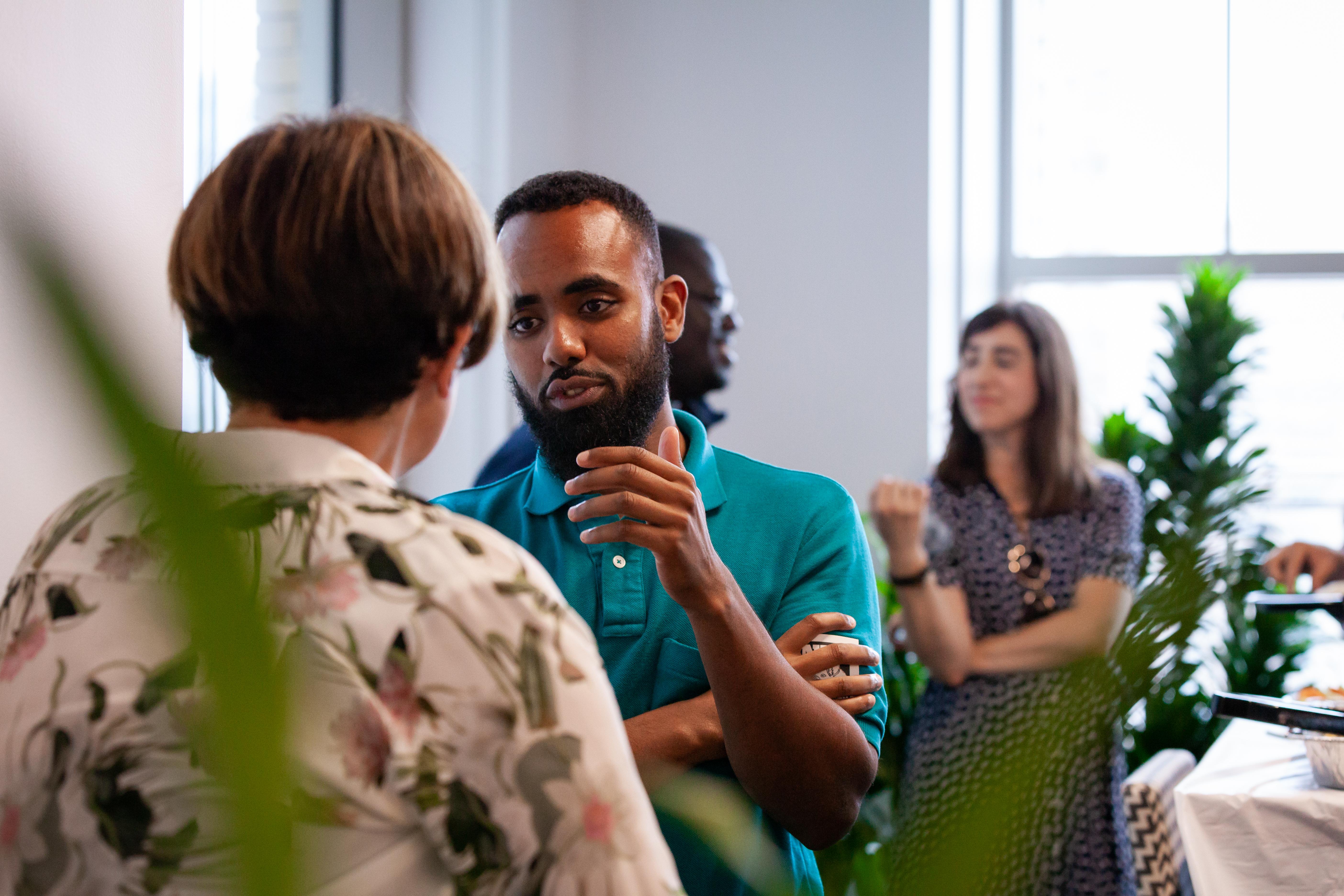 Technologist Muhammad Y. Idiris meets alum Danielle Gustafson.