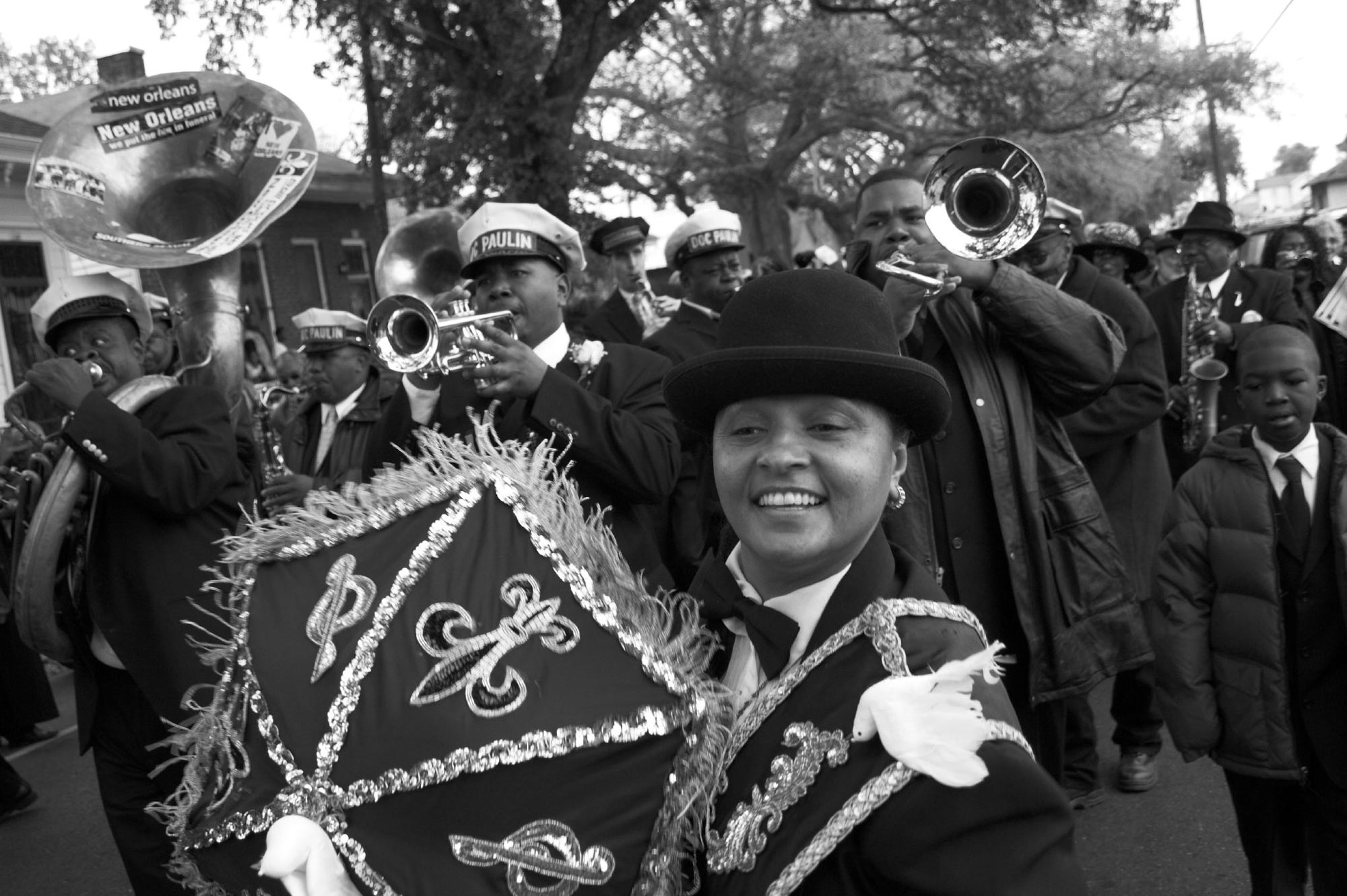 A jazz funeral in New Orleans is held for legendary jazz musician Doc Paulin who led many funerals in New Orleans with his trumpet. Photo by Derek Bridges.