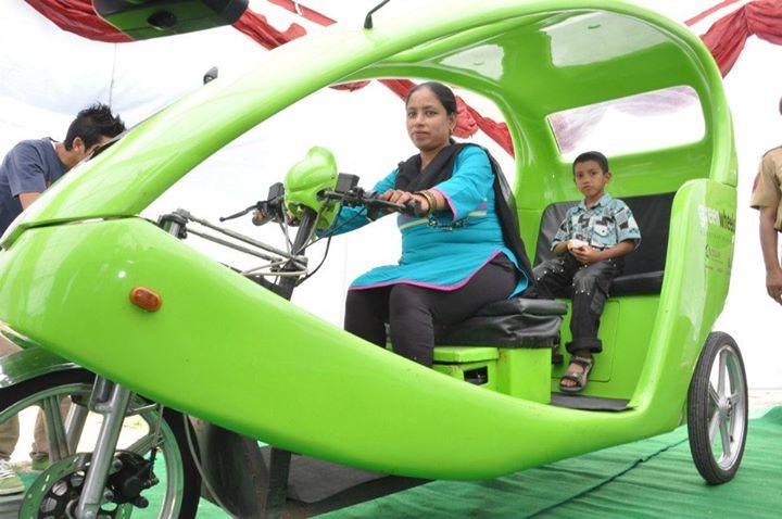 Kohinoor, Delhi's first woman e-rickshaw driver, shown with her son (Photo: IANS)
